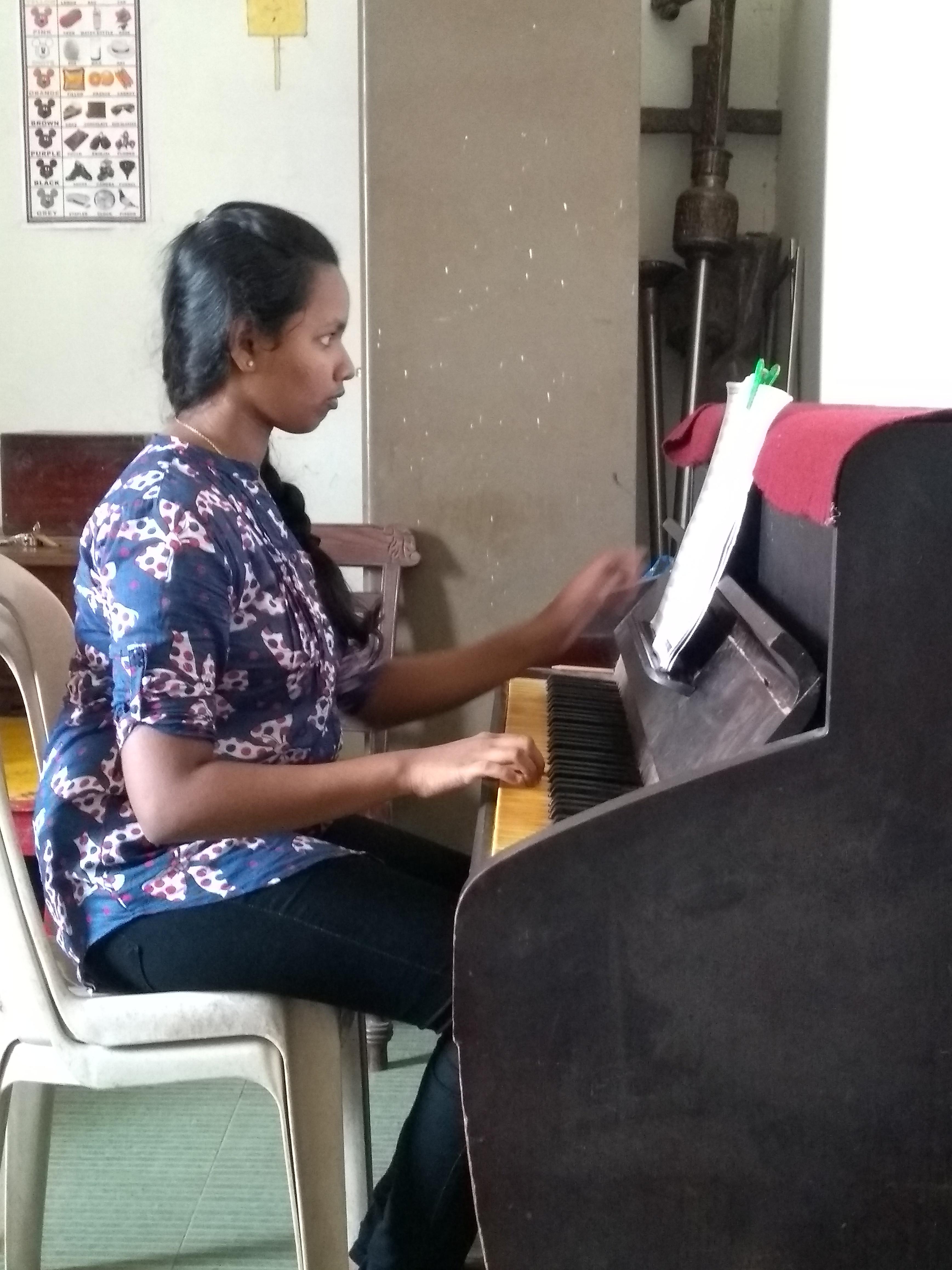 Piano students at St. Cruz